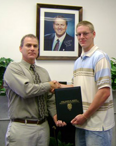 George F. Belanger presenting Taylor Motta the James P. Hoffa Scholarship